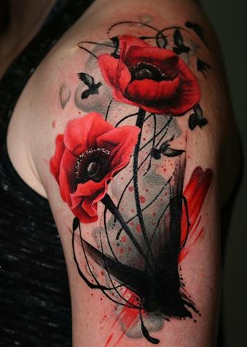 red poppy tattoo on arm